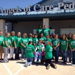 Angels of Care Pediatric Home Health photo: AOC employees dressed in green to celebrate Cerebral Palsy Awareness Day!