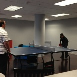 Employees relaxing with a game of table tennis