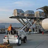 certified Tug driver (me) loading air cargo onto 767 plane