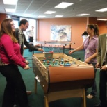 CEO Gabe Tirador challenges the FL employees to a round of Foosball in our new gameroom