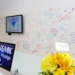 Grand opening. Guest signed the wall with well wishes.