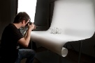 A member of the photography department snaps some product images for the website.