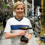 Atlas Copco Tools employee holding a product.