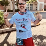 A member of Team ManTech at the finish of the 2018 Marine Corps Historic Half Marathon