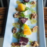 Red and Gold Beets with Herbed Goat Chhese Mousse Local Arugula and Candied Walnuts