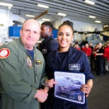 Getting an award from the Commanding officer of USS BOXER (LHD-4)