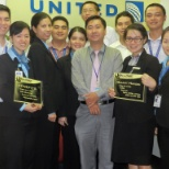 United office at Tan Son Nhat Airport, Ho Chi Minh City, Vietnam, with CS Team and Station Manager