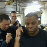 Giving vaccinations to crew members prior to deployment.
