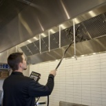 A CASService Field Service Technician tests a CaptiveAire exhaust hood.