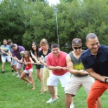 Our President (Justin Byrd) leading up tug-o-war at our Annual Summer Picnic at the National Zoo in