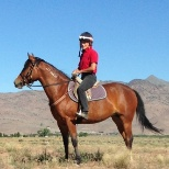 Remuda Ranch photo: One of my starter mustangs and myself on the high desert range summer 2013