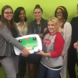 To celebrate graduation from training, these Buffalo claims associates got a Gecko cake!