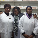 Pharmacist  (middle) and two pharmacist assistants in the dispensary.