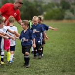 i9 Sports Corporation photo: Learning and showing sportsmanship on the field.