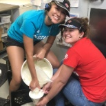 My coworker and I pouring icecream mix into a bag