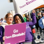 Employees cheer on participants in the Heart Walk
