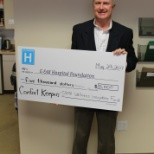 Blaine Bell President of Georgian Triangle Comfort Keepers makes a donation to local hospital.