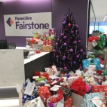 Fairstone photo: This is the season of giving! Wrapping over 100 presents employees purchased for foster children.