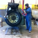 That the one doing changing a commercial tire