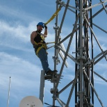 Raytheon photo: Installing Antennas on Radar Tower.