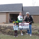 Mastercraft Exteriors photo: Happy Homeowner and 4 year old daughter